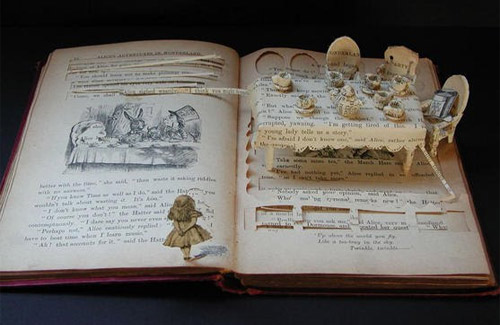 dinner table art in book Impressive Book Sculptures and Cut out Illustrations